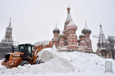 Heavy snowfall in Russia, cars and houses covered with snow